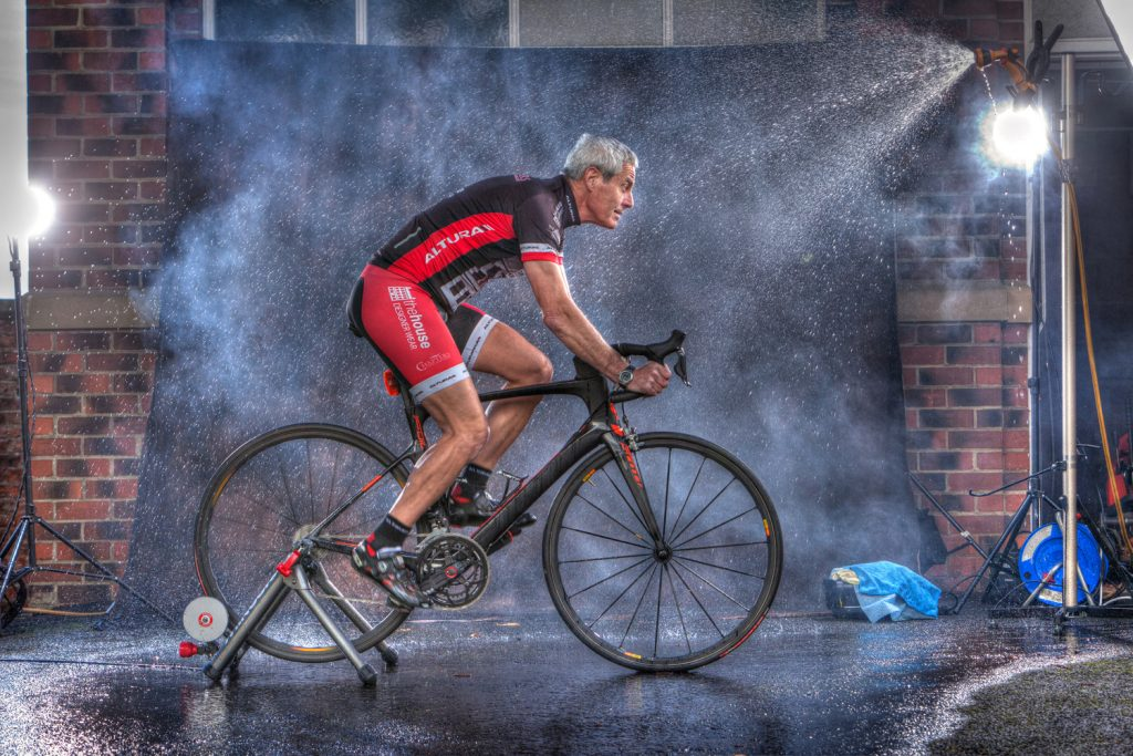 an outdoor set up shot of Steven Bell on a cycle trainer